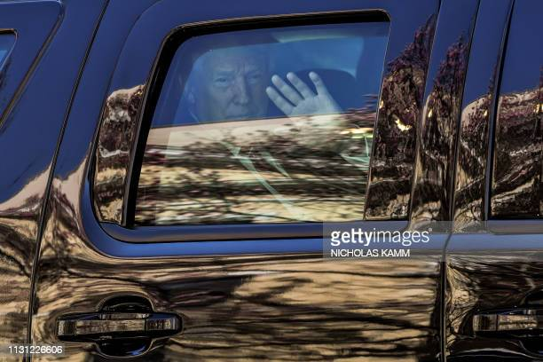 US President Donald Trump and First Lady Melania Trump leave St Johns Episcopal church in the motorcade in Washington DC on March 17 2019