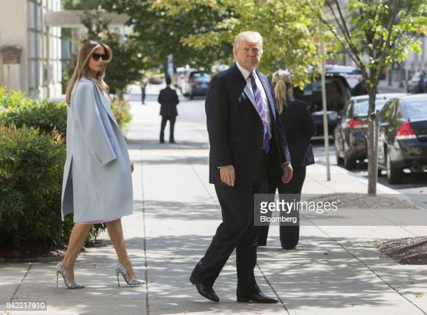 US President Donald Trump and First Lady Melania Trump leave St John's Church after a national day of prayer for the people affected by Hurricane...