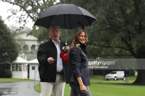 S President Donald Trump and first lady Melania Trump leave the White House October 15 2018 in Washington DC The Trumps are traveling to survey...