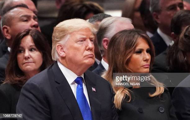 US President Donald Trump and First Lady Melania Trump listen during a funeral service for former US President George H W Bush at the National...