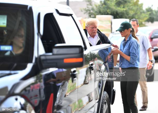 US President Donald Trump and First Lady Melania Trump load supplies for Hurricane Harvey victims at the First Church of Pearland on September 2 in...