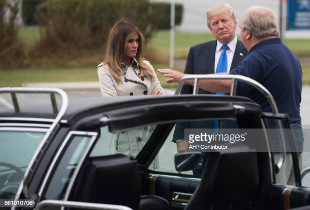 President Donald Trump and First Lady Melania Trump look at a 1983 Cadillac limousine used by former President Ronald Reagan at the United States...
