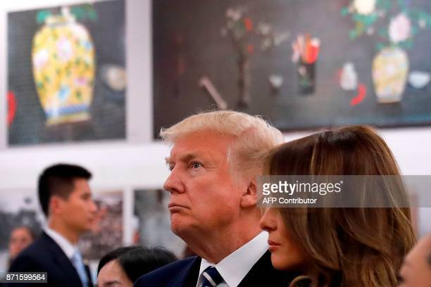 US President Donald Trump and First Lady Melania Trump look at relics as they tour the Conservation Scientific Laboratory of the Forbidden City in...