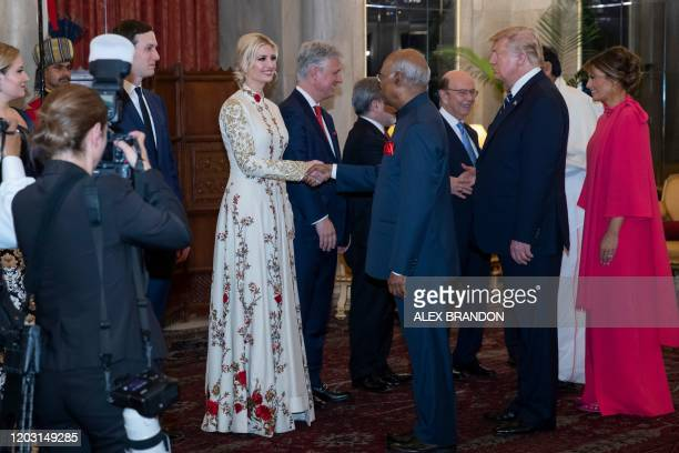 US President Donald Trump and First Lady Melania Trump look on as India's President Ram Nath Kovind greet White House senior adviser Ivanka Trump...