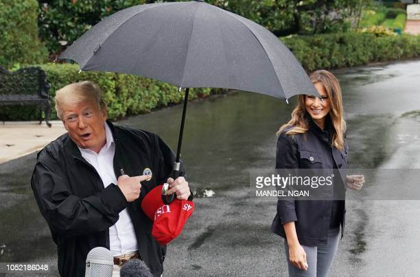 US President Donald Trump and First Lady Melania Trump make their way to board Marine One from the South Lawn of the White House in Washington DC on...