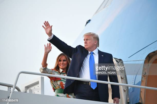 President Donald Trump and First Lady Melania Trump make their way to board Air Force One before departing from Andrews Air Force Base in Maryland on...