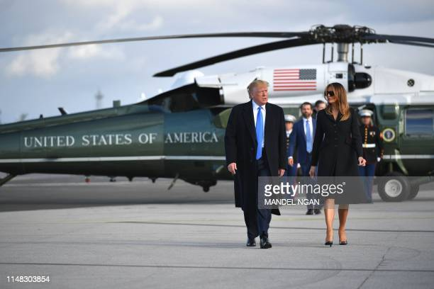 US President Donald Trump and First Lady Melania Trump make their way to board Air Force One at Shannon Airport in Shannon Ireland on June 6 2019 and...