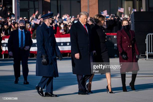 President Donald Trump and First Lady Melania Trump make their way to Air Force One at Joint Base Andrews before boarding Air Force One for his last...