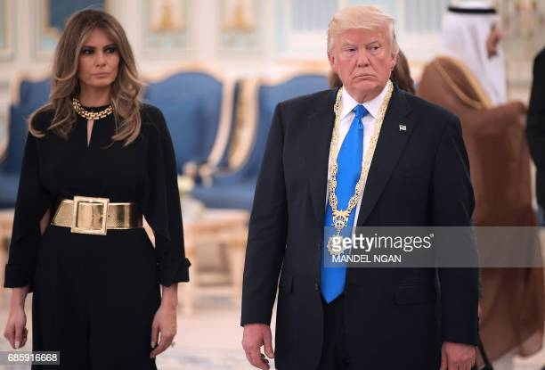 US President Donald Trump and First Lady Melania Trump make their way to a luncheon after Trump received the Order of Abdulaziz alSaud medal from...