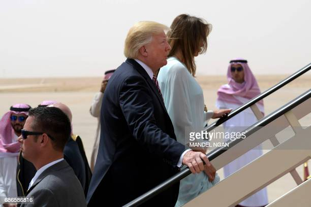 US President Donald Trump and First Lady Melania Trump make their way to board Air Force One in Riyadh as they head to Israel on May 22 2017 / AFP...