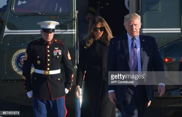 US President Donald Trump and First Lady Melania Trump make their way to board Air Force One before departing from Andrews Air Force Base in Maryland...