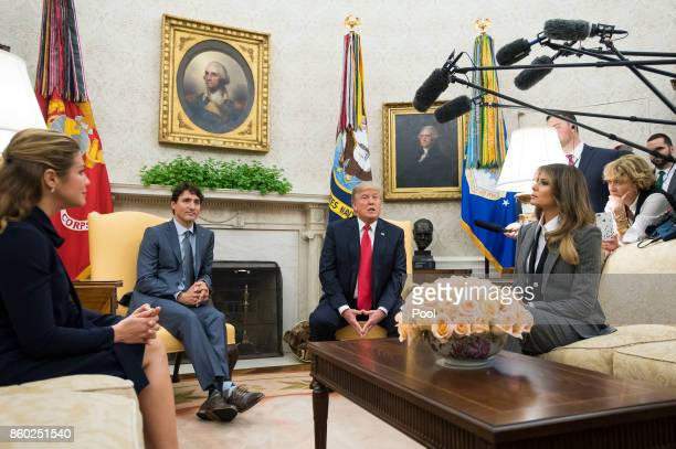 US President Donald Trump and first lady Melania Trump meet with Canadian Prime Minister Justin Trudeau and his wife Gregoire Trudeau in the Oval...