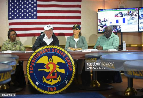 US President Donald Trump and First Lady Melania Trump meet with US Virgin Islands Governor Kenneth Mapp in the Ward Room aboard the USS Kearsarge...