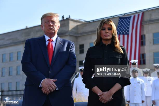 US President Donald Trump and First Lady Melania Trump observe a moment of silence during a ceremony marking the 18th anniversary of the 9/11 attacks...