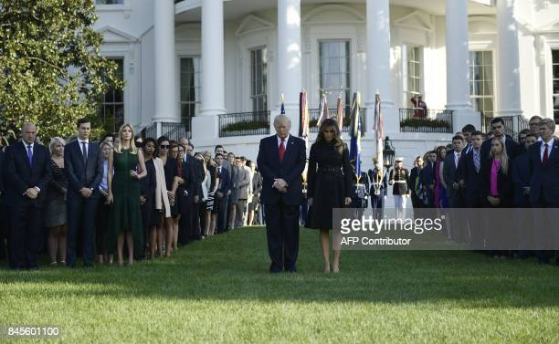 US President Donald Trump and First Lady Melania Trump observe a moment of silence on September 11 at the White House in Washington DC during the...