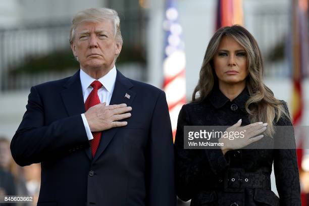 S President Donald Trump and first lady Melania Trump observe a moment of silence on the South Lawn for the September 11 terrorist attacks September...