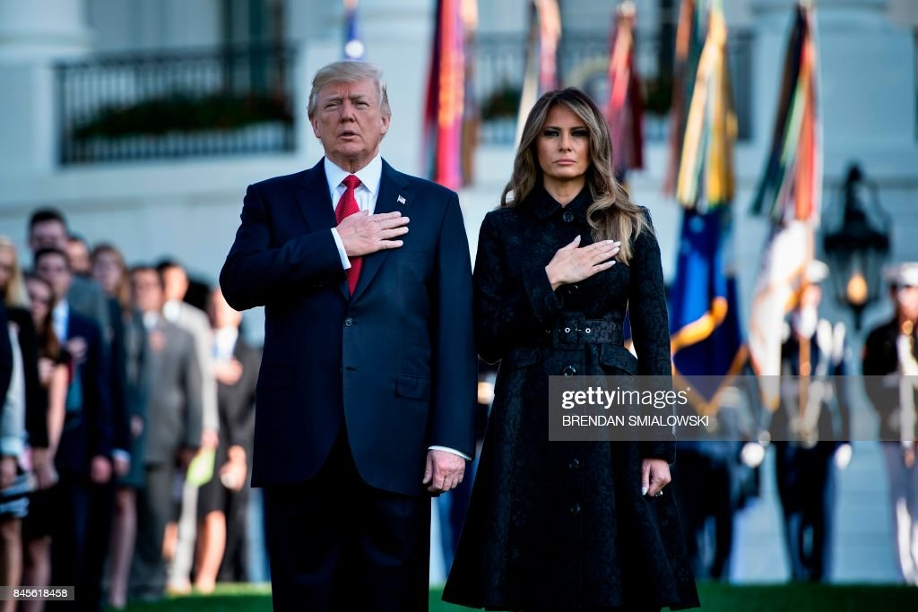 President Donald Trump and First Lady Melania Trump observe a moment of silence on September 11, 2017, at the White House in Washington, DC, during the 16th anniversary of 9/11. / AFP PHOTO / Brendan Smialowski