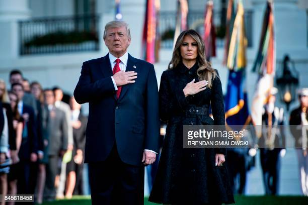 President Donald Trump and First Lady Melania Trump observe a moment of silence on September 11 at the White House in Washington DC during the 16th...