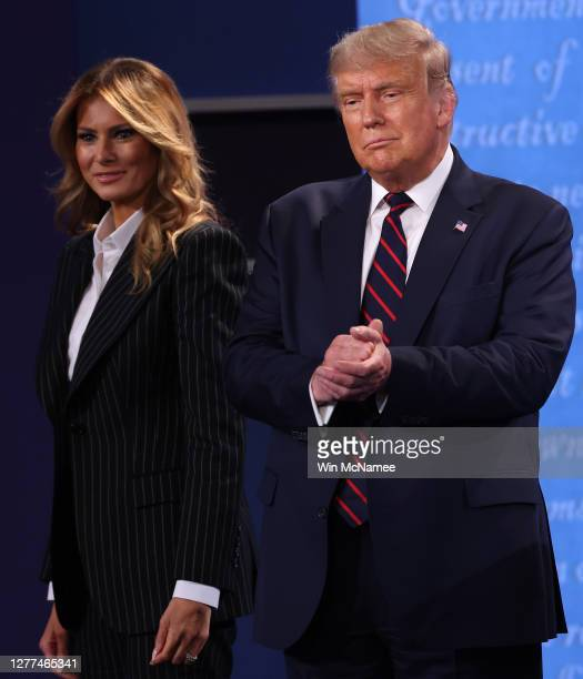 President Donald Trump and first lady Melania Trump on stage after the first presidential debate between Trump and Democratic presidential nominee...