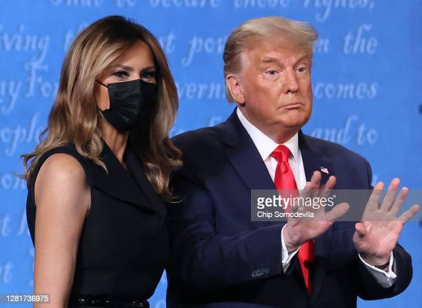 President Donald Trump and first lady Melania Trump on stage after the final presidential debate against Democratic presidential nominee Joe Biden at...
