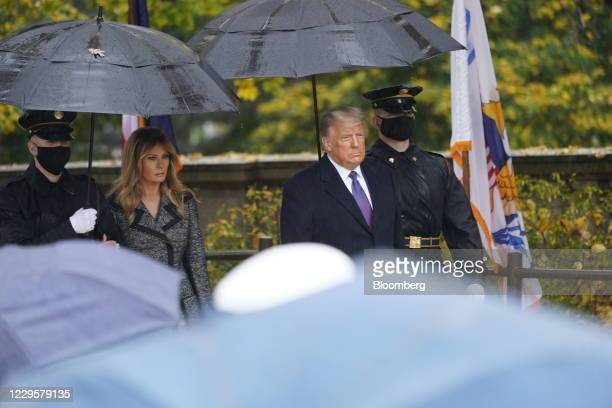 President Donald Trump and First Lady Melania Trump participate in a National Veterans Day ceremony in Arlington, Virginia, U.S., on Wednesday, Nov....
