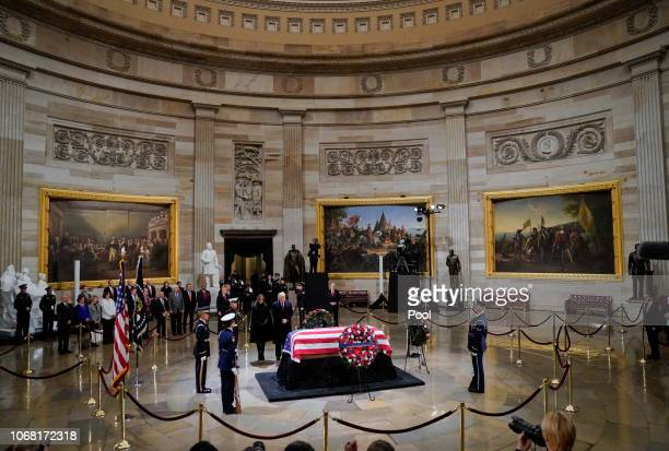 S President Donald Trump and first lady Melania Trump pay their respects as former US President George HW Bush lies in state in the US Capitol...