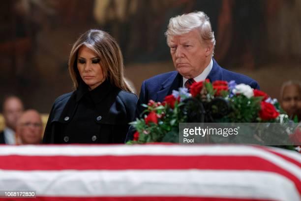 President Donald Trump and first lady Melania Trump pay their respects to former President George HW Bush as he lies in state in the US Capitol...