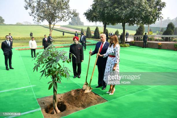 US President Donald Trump and First Lady Melania Trump plant a tree as they pay tribute at Raj Ghat the memorial for Indian independence icon Mahatma...
