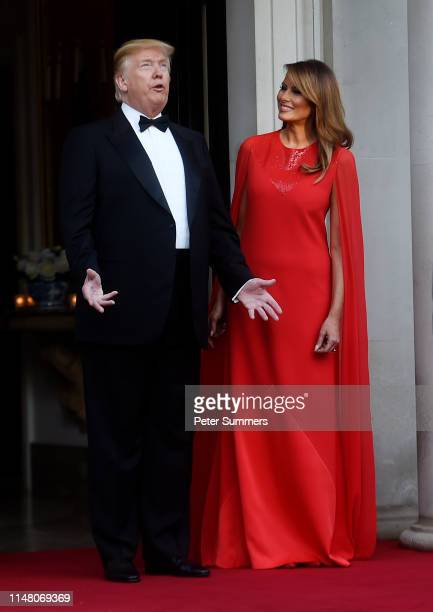 President Donald Trump and First Lady Melania Trump pose ahead of a dinner at Winfield House for Prince Charles, Prince of Wales and Camilla, Duchess...