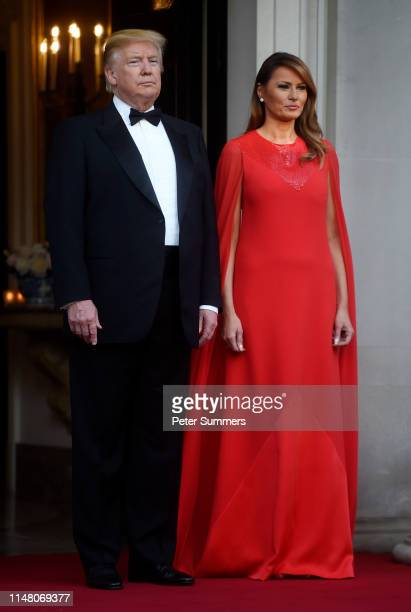 President Donald Trump and First Lady Melania Trump pose ahead of a dinner at Winfield House for Prince Charles Prince of Wales and Camilla Duchess...