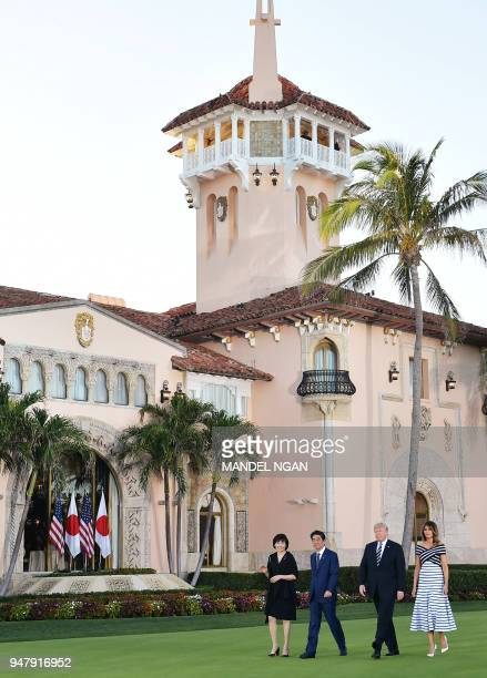 US President Donald Trump and First Lady Melania Trump pose for a photo with Japan's Prime Minister Shinzo Abe and wife Akie Abe as they arrive for...