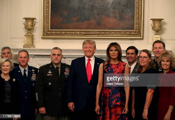 S President Donald Trump and first lady Melania Trump pose for a picture with senior military leaders and their wives before a social dinner at the...