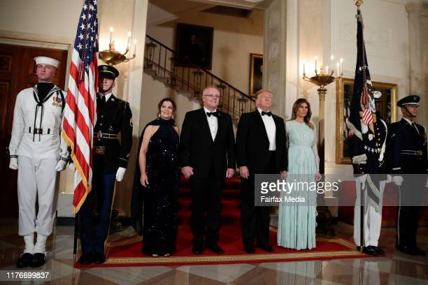 US President Donald Trump and First Lady Melania Trump pose for photos with Australian Prime Minister Scott Morrison and his wife Jenny Morrison...
