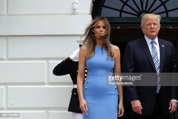 S President Donald Trump and first lady Melania Trump pose for photographs with Panamanian President Juan Carlos Varela and his wife Lorena Castillo...
