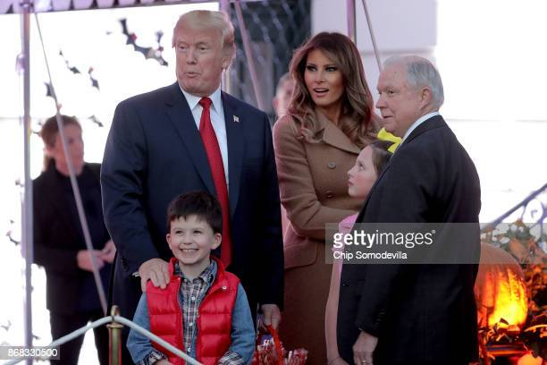 S President Donald Trump and first lady Melania Trump pose for photographs with Attorney General Jeff Sessions and the children he was accompanying...
