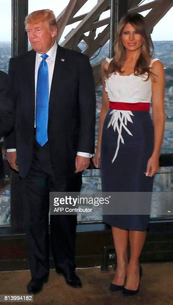 US President Donald Trump and First Lady Melania Trump pose upon their arrival for a dinner with French President and his wife at Le Jules Verne...