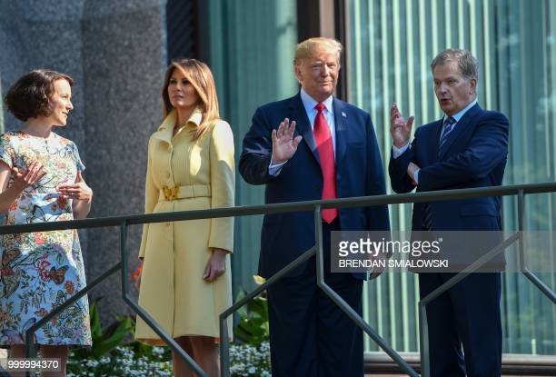 US President Donald Trump and First Lady Melania Trump pose with Finnish President Sauli Niinisto and his wife Jenni Haukio at the Mantyniemi...