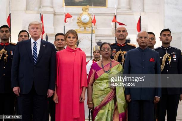 US President Donald Trump and First Lady Melania Trump pose with India's President Ram Nath Kovind and his wife Savita Kovind during a state banquet...