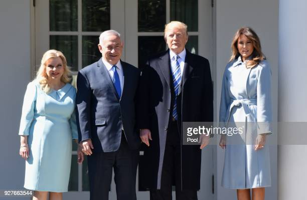 President Donald Trump and first lady Melania Trump pose with Israel Prime Minister Benjamin Netanyahu and Sara Netanyahu in the Oval Office of the...
