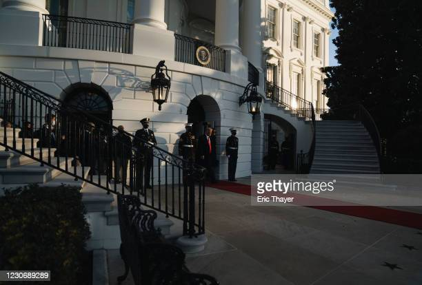 President Donald Trump and first lady Melania Trump prepare to depart the White House on January 20, 2021 in Washington, DC. Trump is making his...