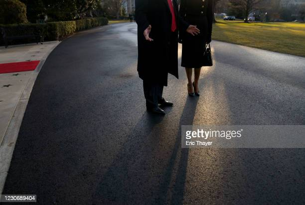 President Donald Trump and first lady Melania Trump prepare to depart the White House on Marine One on January 20, 2021 in Washington, DC. Trump is...
