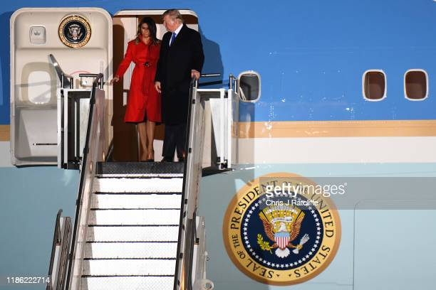 President Donald Trump and First lady Melania Trump prepare to embark from Air Force One as they arrive at Stansted Airport on December 2, 2019 in...