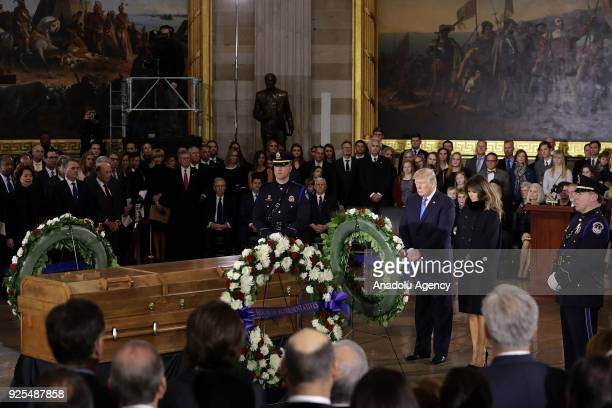 S President Donald Trump and first lady Melania Trump present a wreath at Christian evangelist and Southern Baptist minister Billy Graham's casket as...