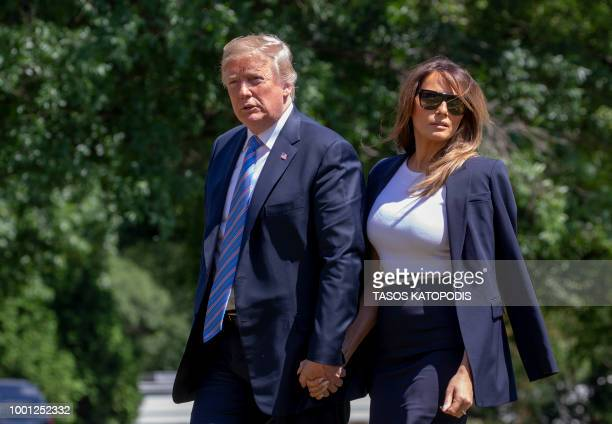 S President Donald Trump walks along the Rose Garden colonnade after he and first lady Melania Trump returned to the White House July 18 2018 in...