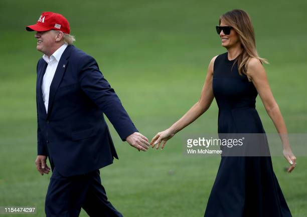 S President Donald Trump and first lady Melania Trump return to the White House June 7 2019 in Washington DC Trump returned to the White House after...