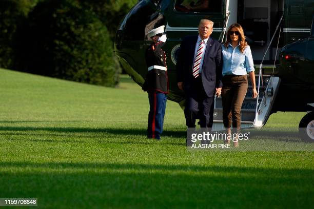 US President Donald Trump and First Lady Melania Trump return to the White House in Washington DC on August 4 2019 The United States was in mourning...