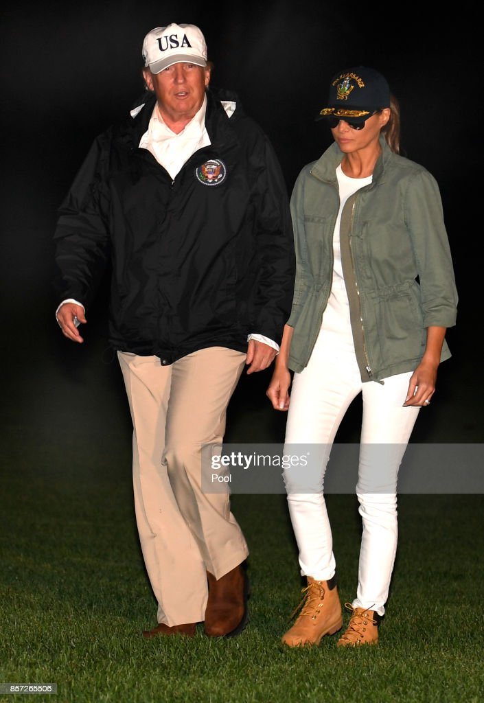 U.S. President Donald Trump and first lady Melania Trump return to the White House after a day trip to Puerto Rico where they viewed damage from Hurricane Irma October 3, 2017 in Washington, DC.