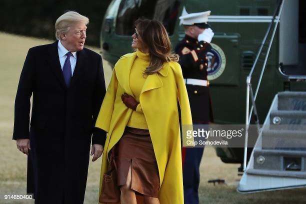 S President Donald Trump and first lady Melania Trump return to the White House after a day trip to Cincinnati Ohio February 5 2018 in Washington DC...