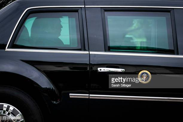 President Donald Trump and first lady Melania Trump ride in a motorcade as they depart from the White House on May 25, 2020 in Washington, DC. The...