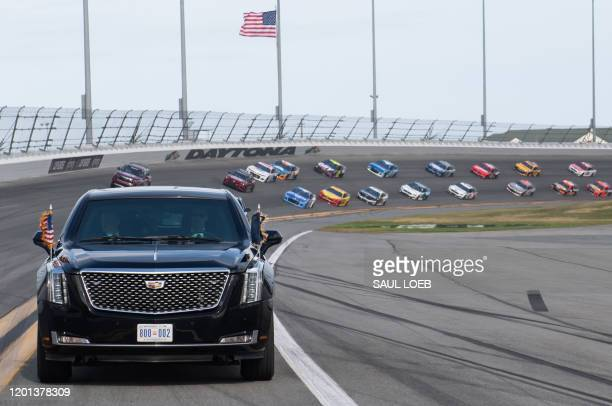 President Donald Trump and First Lady Melania Trump ride in the Presidential limousine as they take a pace lap ahead of the start of the Daytona 500...